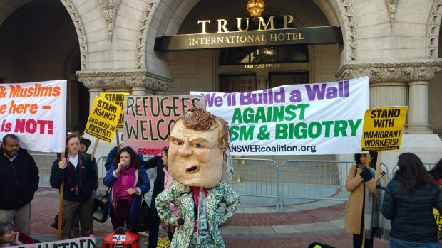 Protesters from Code Pink speak outside Trump International Hotel. (Steve Birr/TheDCNF)