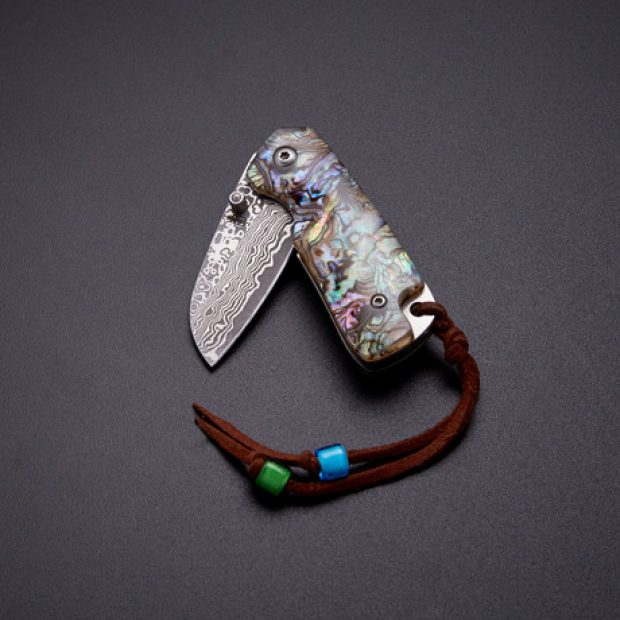 You can save $80 on this abalone folder today (Photo via Touch of Modern)