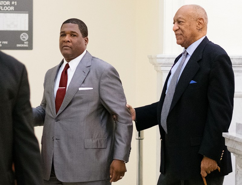 Cosby is escorted back to the courtroom (Photo credit: REUTERS/Ed Hille/Pool)