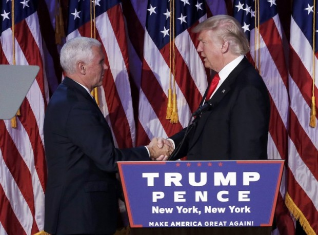 U.S. President-elect Donald Trump greets his running mate Mike Pence during his election night rally in Manhattan, New York, U.S., November 9, 2016. REUTERS/Mike Segar