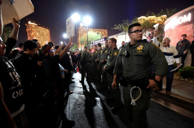 Las Vegas police stand between protesters against and supporters of the election of Republican Donald Trump as President of the United States, near the Trump International Hotel & Tower in Las Vegas, Nevada, November12, 2016. REUTERS/David Becker