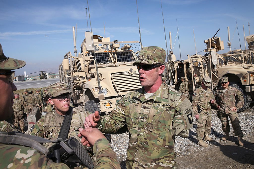 U.S. Army SGT (retired) Noah Galloway (C) from Birmingham, Alabama meets with soldiers preparing for a patrol at FOB Fenty on March 12, 2014 near Jalalabad, Afghanistan. (Photo by Scott Olson/Getty Images)