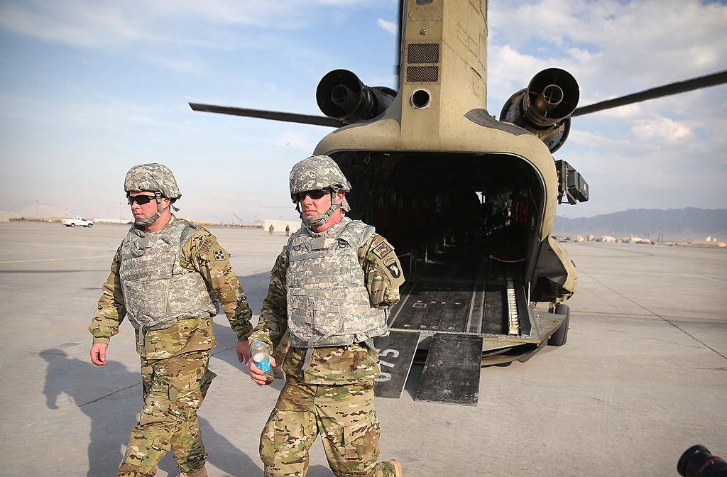 U.S. Army SGT (retired) Daniel Harrison (L) from Atlanta, Texas, and SGT (retired) Noah Galloway from Birmingham, Alabama, return to Bagram Airfield after visiting a forward operating base near Bagram, Afghanistan. (Photo by Scott Olson/Getty Images)