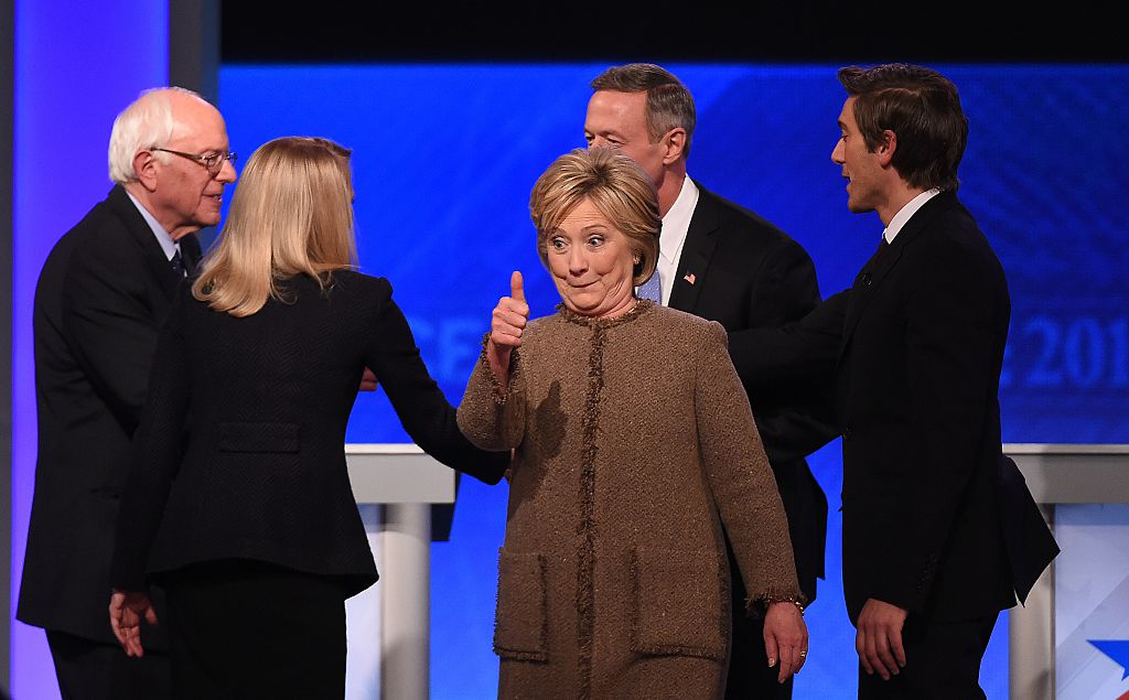 Hillary Clinton gives a thumbs up as fellow candidates Bernie Sanders and Martin O'Malley greet mediators at the end of the Democratic Presidential Debate hosted by ABC (Getty Images)