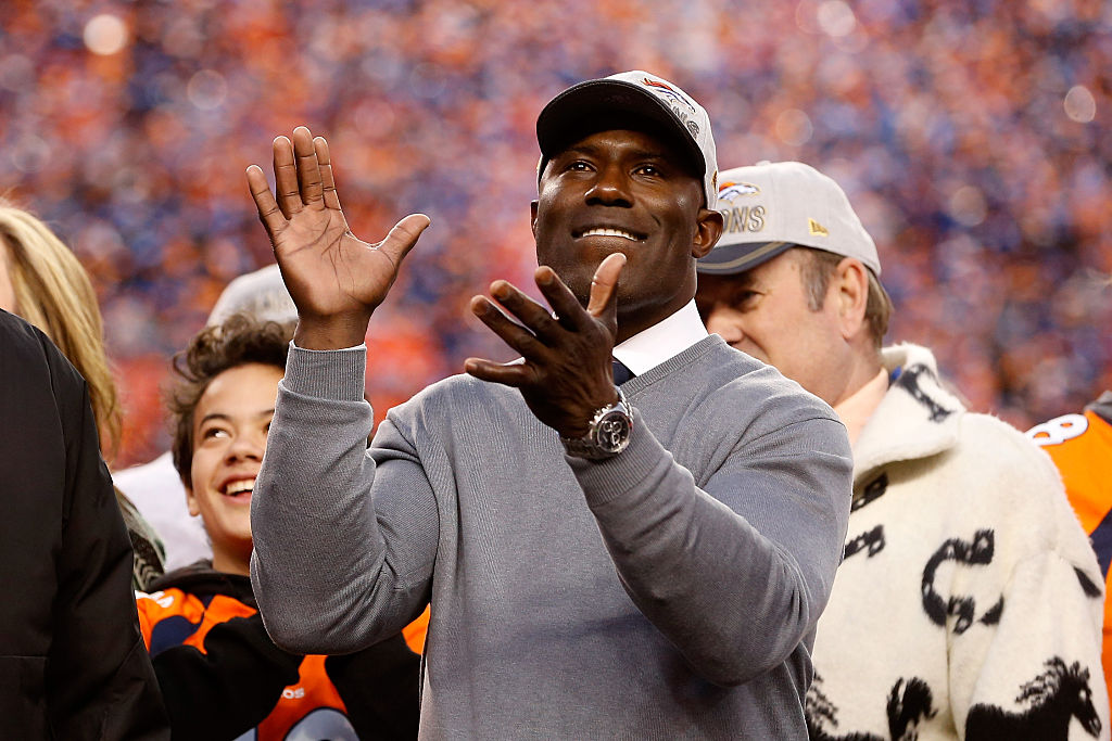 Former Denver Bronco Shannon Sharpe celebrates after defeating the New England Patriots in the AFC Championship game. (Photo by Christian Petersen/Getty Images)