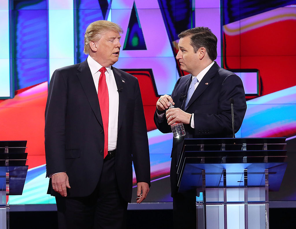 Donald Trump and Ted Cruz talk during a broadcast break in the CNN, Salem Media Group, The Washington Times Republican Presidential Primary Debate (Getty Images)