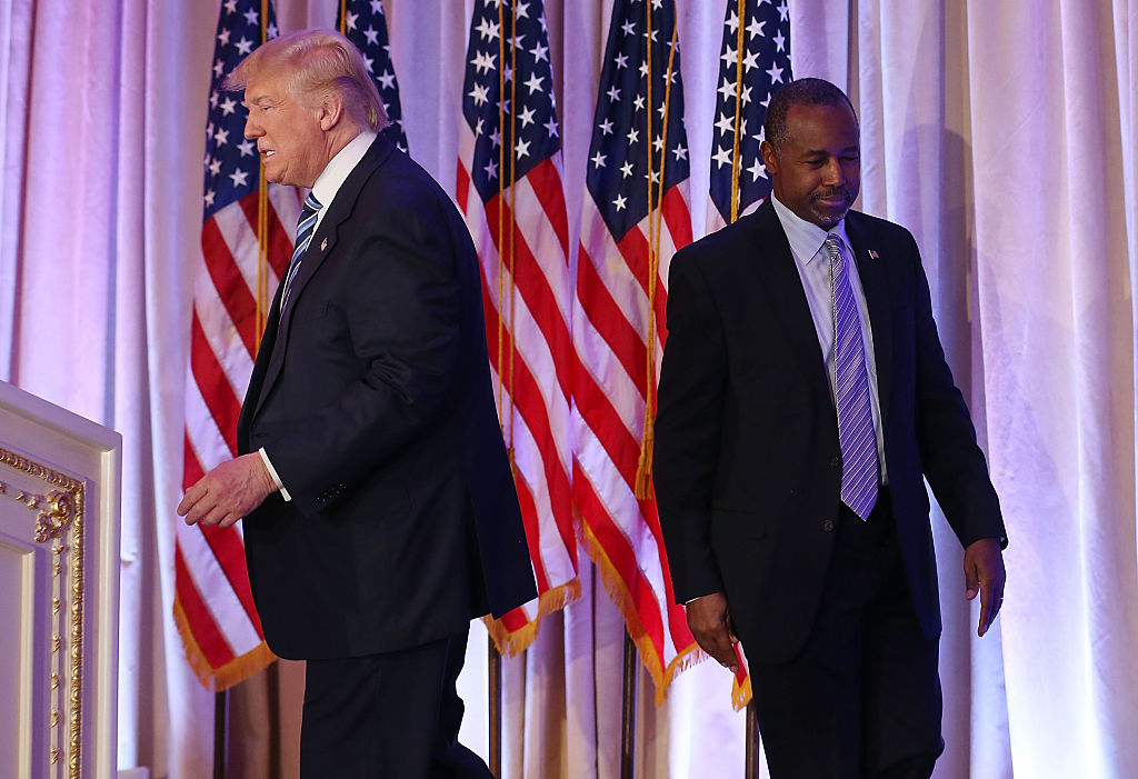 Donald Trump and Ben Carson are seen as Mr. Trump receives his endorsement during a press conference at the Mar-A-Lago Club on March 11, 2016 (Getty Images)