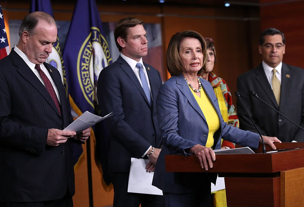 Eric Swalwell stands behind Nancy Pelosi at a press conference in Washington, D.C. (Getty Images)
