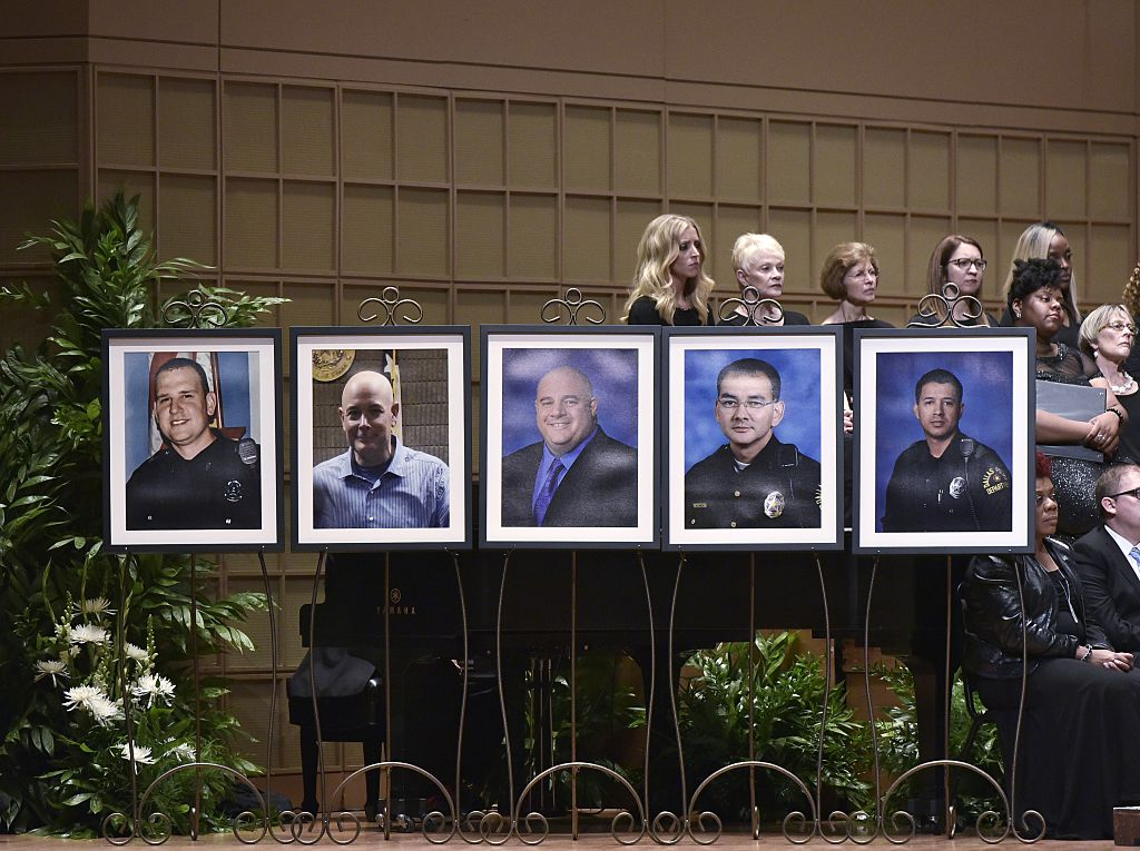 Photos of the victims of the Dallas police shooting at an interfaith memorial service at the Morton H. Meyerson Symphony Center on July 12, 2016 in Dallas, Texas. (Photo credit should read MANDEL NGAN/AFP/Getty Images)