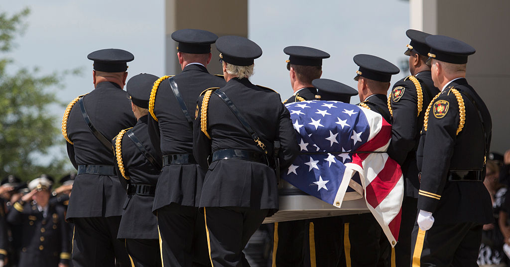 An Honor Guard escorts the casket one of the officers killed July 7 by a gunman during a protest in downtown Dallas. (Photo credit: LAURA BUCKMAN/AFP/Getty Images)
