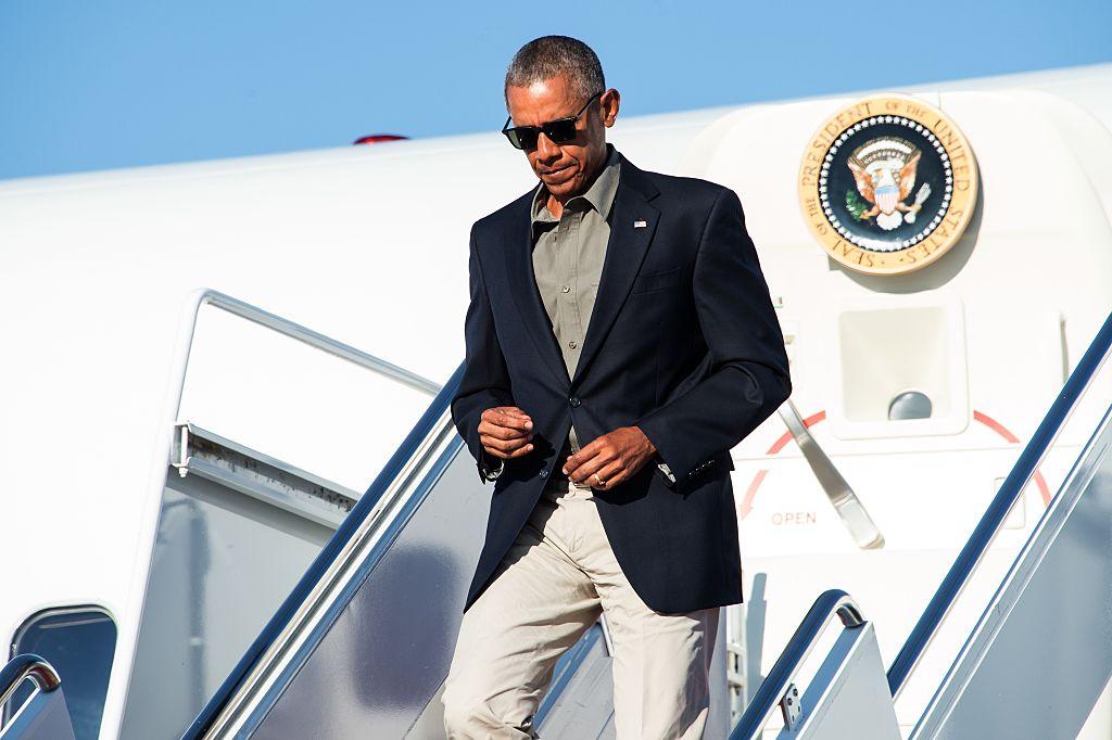 President Barack Obama steps off Air Force One. (Photo credit should read NICHOLAS KAMM/AFP/Getty Images)