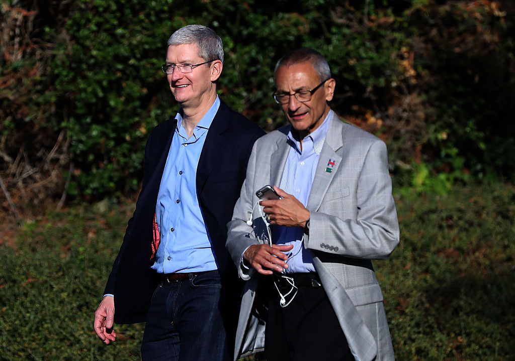 Apple CEO Tim Cook and Hillary Clinton campaign chairman John Podesta leave a fundraiser for Democratic presidential nominee Hillary Clinton on August 24, 2016 in Los Altos Hills, California. (Getty Images)
