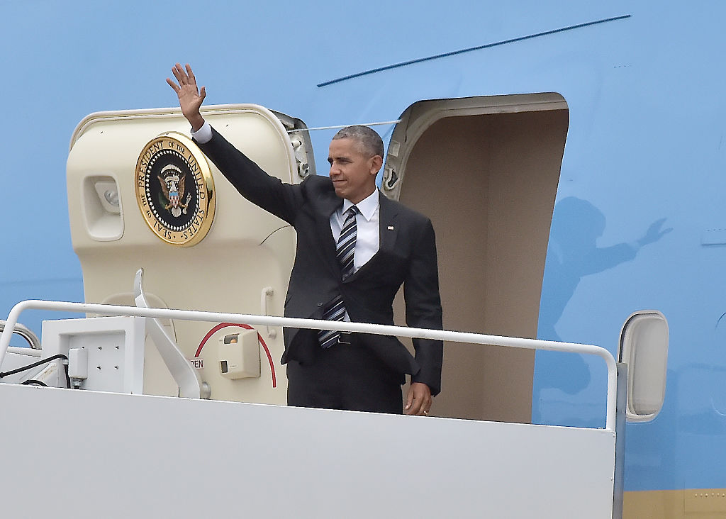 President Barack Obama waves as he boards Air Force One. (Photo by Ron Sachs-Pool/Getty Images)
