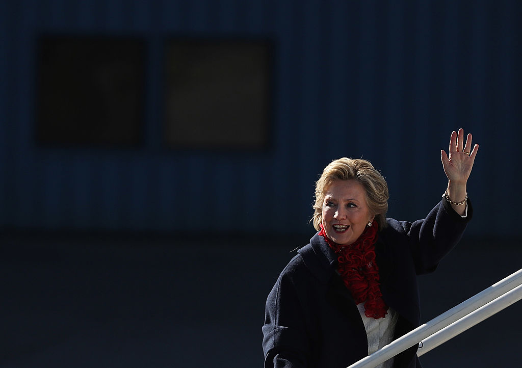 Hillary Clinton waves as she boards her campaign plane at Westchester County Airport on November 1, 2016 (Getty Images)