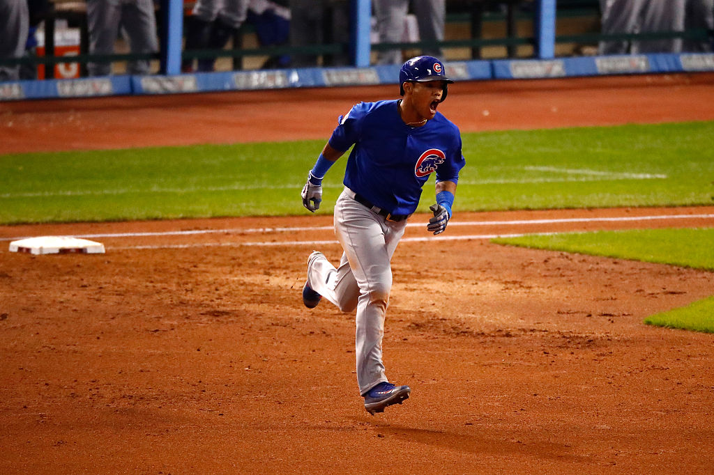 Addison Russell rounds the bases after hitting a grand slam home run during the third inning. (Photo by Gregory Shamus/Getty Images)