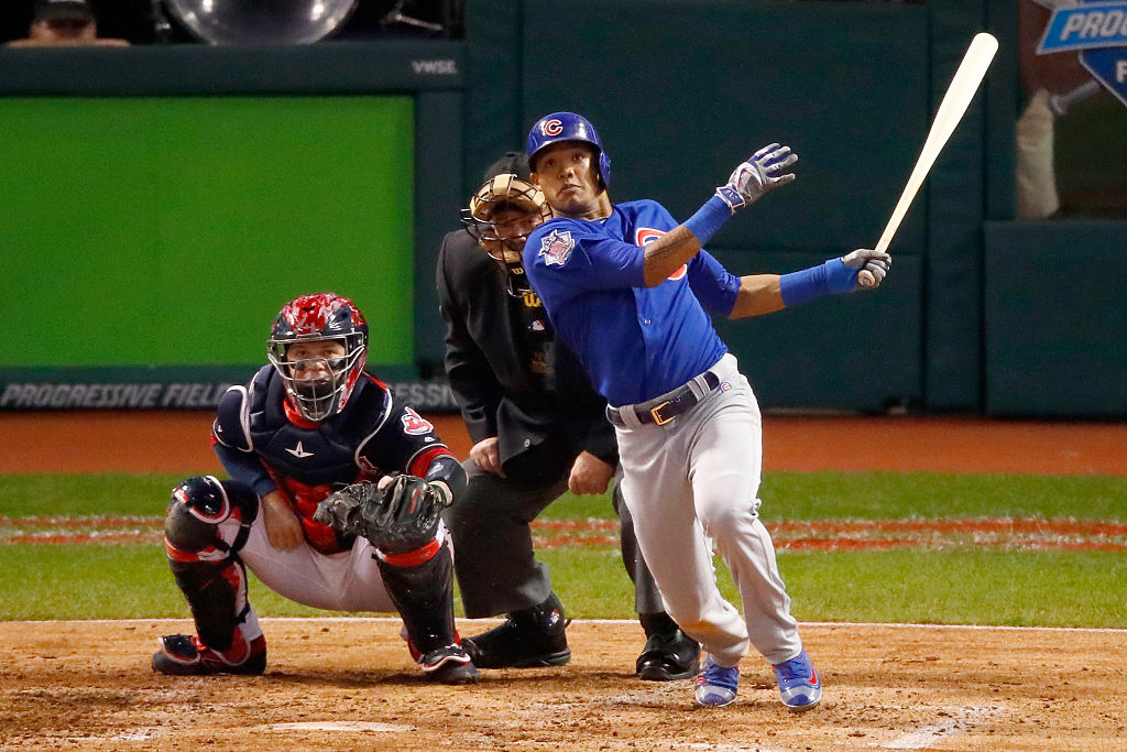 Addison Russell hits a grand slam home run during the third inning. (Photo by Gregory Shamus/Getty Images)
