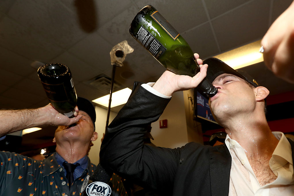 Actor Bill Murray (L) celebrates in the clubhouse with President of Baseball Operations for the Chicago Cubs Theo Epstein after the Cubs defeated the Cleveland Indians 8-7 in Game Seven of the 2016 World Series. (Photo by Elsa/Getty Images)