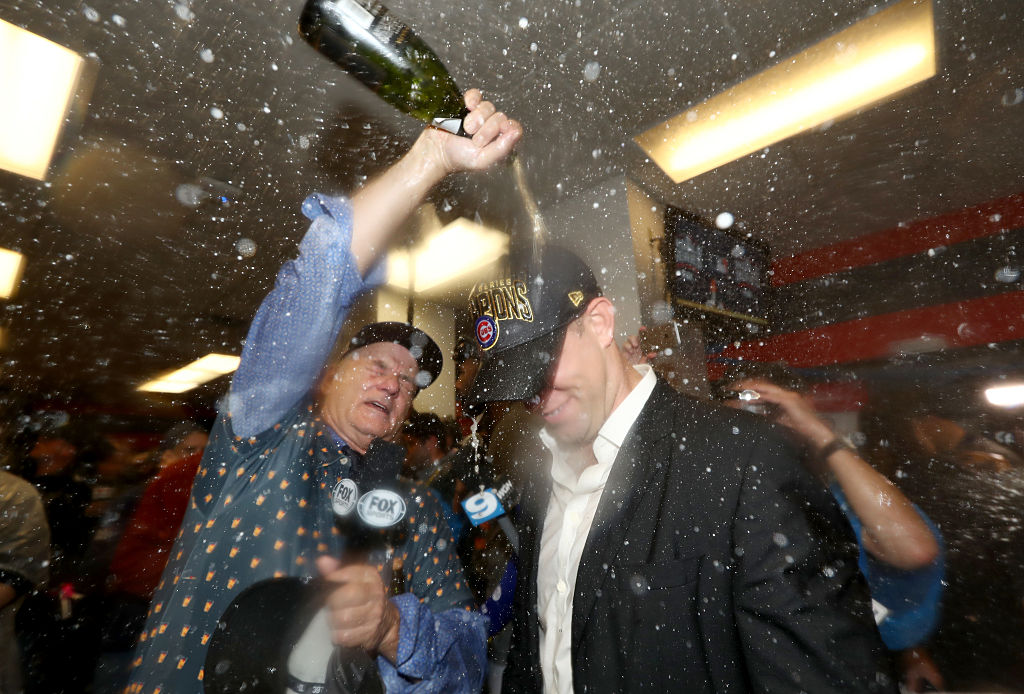 Murray pours champagne on Cubs President Theo Epstein. (Photo credit: Getty Images)