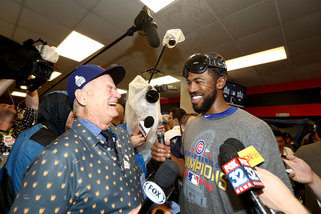 Bill Murray celebrates with the Cubs players in the clubhouse. (Photo credit: Getty Images)