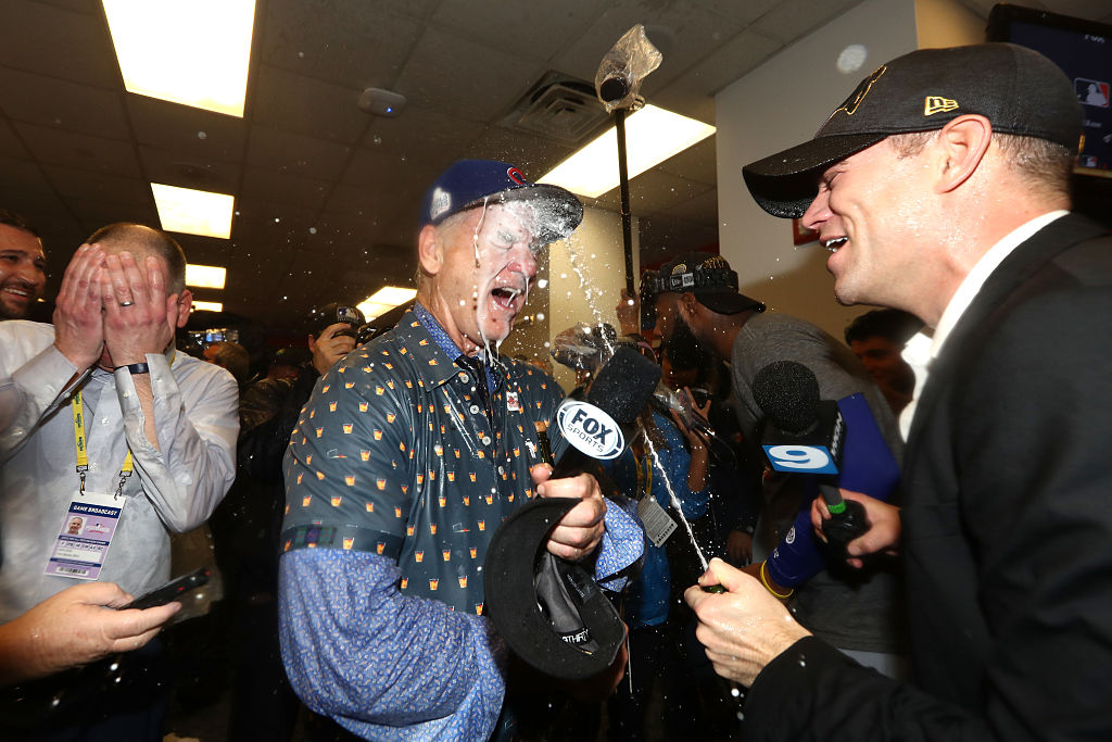 Theo Epstein shoots champagne at Bill Murray in the locker room (Photo credit: Getty Images)