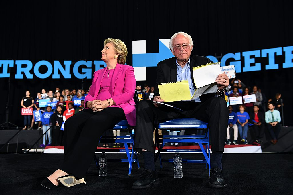 Hillary Clinton and Bernie Sanders listen to singer Pharrell Williams during a campaign rally in Raleigh, North Carolina, on November 3, 2016 (Getty Images)