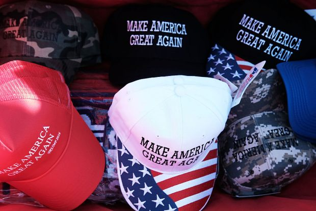 "HERSHEY, PA - NOVEMBER 04: Donald Trump ""Make America Great Again"" hats are sold at a rally on November 4, 2016 in Hershey, Pennsylvania. Days before the presidential election, both Hillary Clinton and Donald Trump make their final pitches to the American people, with recent polls show a tightening race in crucial swing states. (Photo by Spencer Platt/Getty Images)"