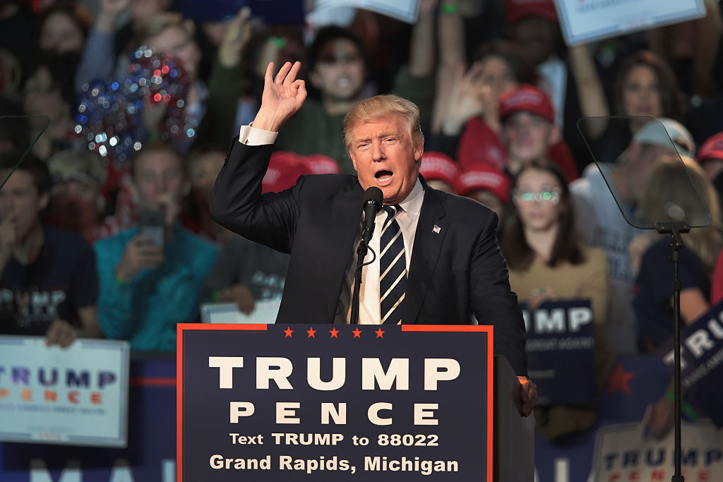 Donald Trump addresses supporters during a campaign rally on November 7, 2016 in Grand Rapids, Michigan (Getty Images)