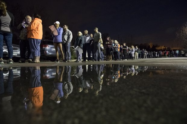 Voters wait for polls to open on November 8, 2016 at the Midwest Genealogy Center Library in Independence, Missouri, United States.(Photo by Whitney Curtis/Getty Images)