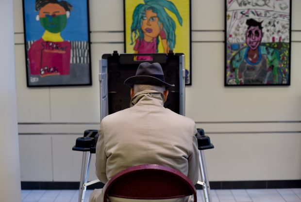 Voters cast their ballots in the presidential election at the Greenwich High School polling place in Greenwich, Connecticut November 8, 2016. (TIMOTHY A. CLARY/AFP/Getty Images)