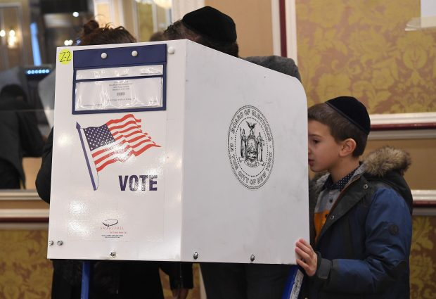 Voters cast their ballots in the presidential election at the East Midwood Jewish Center polling station in the Brooklyn borough of New York City on November 8, 2016. (ANGELA WEISS/AFP/Getty Images)