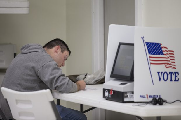 A voter casts his ballot on November 8, 2016 at Sibley Community Center in Sibley, Missouri, United States. Americans across the nation are picking their choice for the next president of the United States. (Photo by Whitney Curtis/Getty Images)