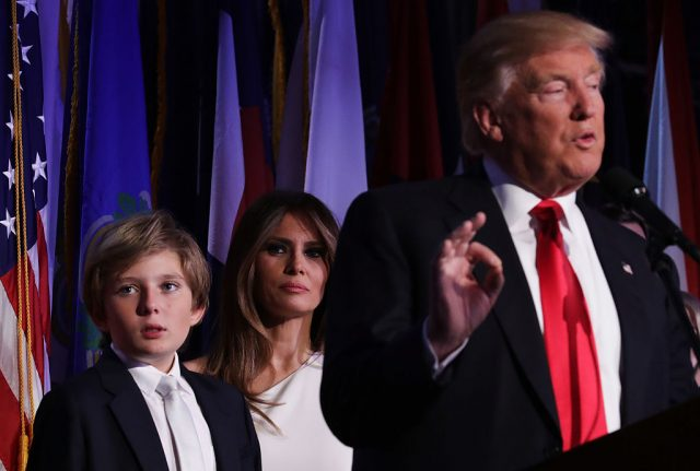 Republican president-elect Donald Trump delivers his acceptance speech as his son Barron Trump and wife Melania Trump looks on during his election night event at the New York Hilton Midtown in the early morning hours of November 9, 2016 in New York City. (Photo by Chip Somodevilla/Getty Images)