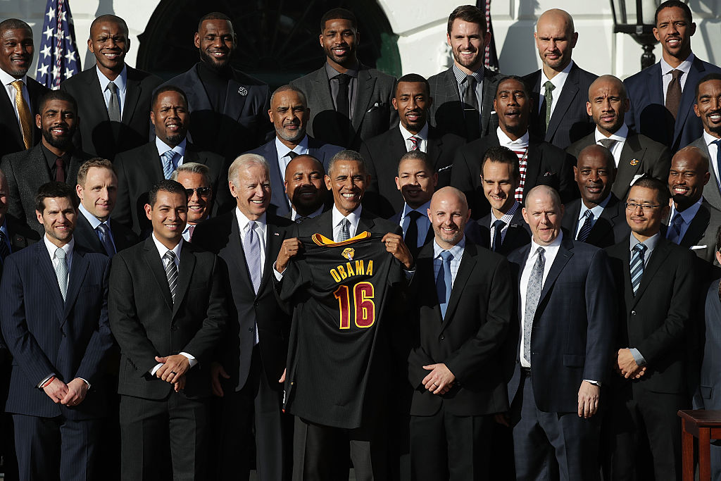 President Barack Obama and Vice President Joseph Biden pose for photos with members of the Cleveland Cavaliers. (Photo by Alex Wong/Getty Images)