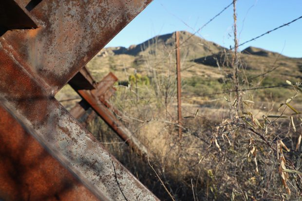 """An anti-vehicle """"Normandy fence"""" and a fence of barbed wire stretch along the U.S.-Mexico border on November 14, 2016 near Arivaca, Arizona. (John Moore/Getty Images)"""