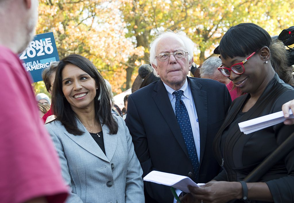 Tulsi Gabbard stands next to Bernie Sanders on Capitol Hill on November 17, 2016 (Getty Images)