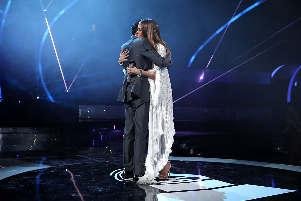 Anthony and Lopez share a hug onstage during The 17th Annual Latin Grammy Awards. (Photo credit: Getty Images)
