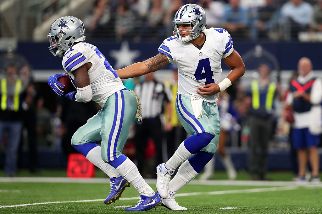 Dak Prescott #4 hands off to Ezekiel Elliott #21 of the Dallas Cowboys. (Photo by Tom Pennington/Getty Images)
