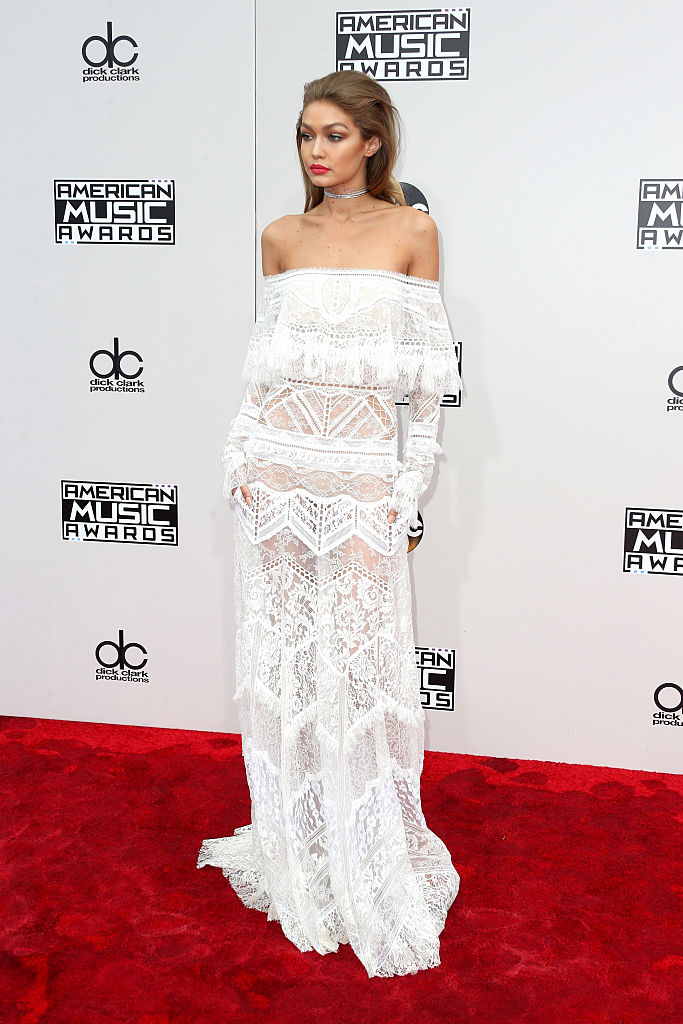 Gigi Hadid on the red carpet before hosting the AMAs. (Photo credit: Getty Images)