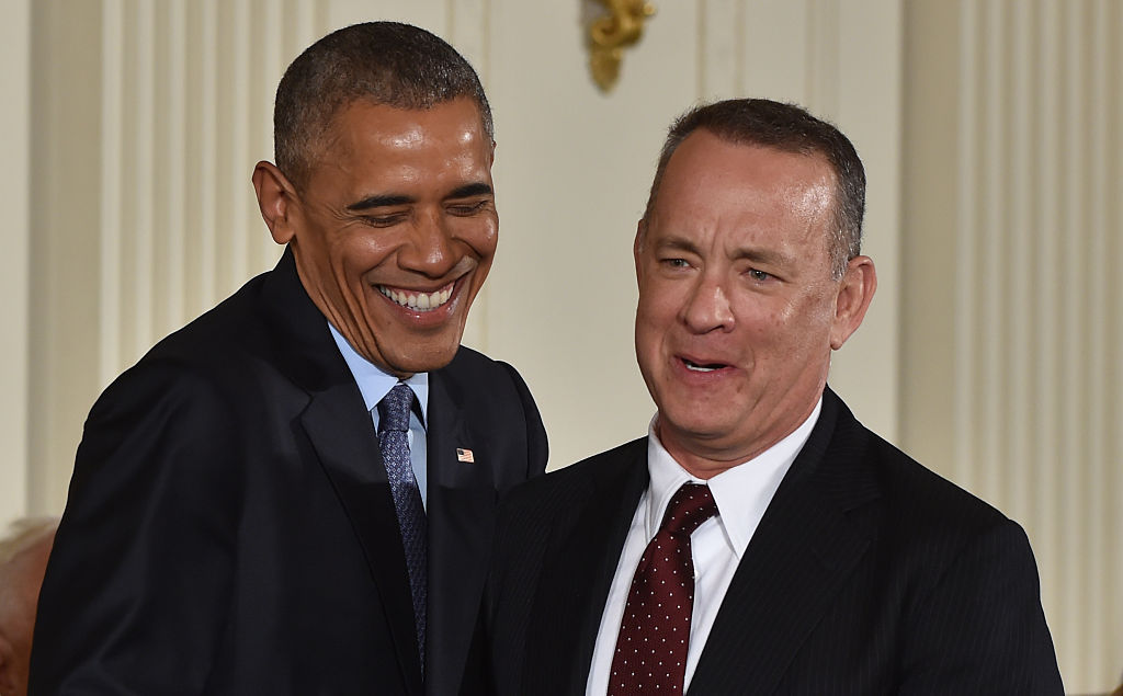 Barack Obama laughs before presenting Tom Hanks the Presidential Medal of Freedom (Getty Images)