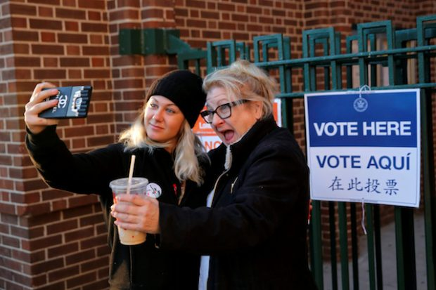 First time voter Kaeli Askea poses for a selfie with her mother Erin Collins-Askea after voting for the U.S presidential election at the James Weldon Johnson school in the East Harlem neighbourhood of Manhattan, New York City , U.S. November 8, 2016. REUTERS/Andrew Kelly