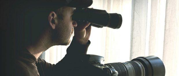 Man with binoculars [Shutterstock - gualtiero boffi]