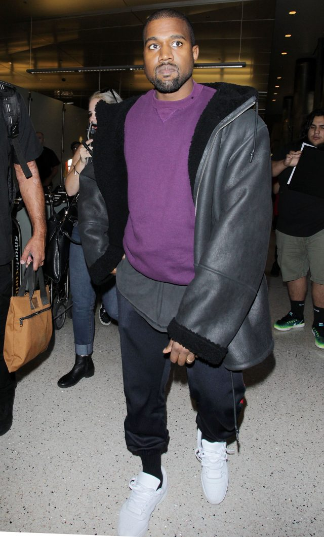 Kanye West arrives at the Los Angeles International Airport. (Photo: Splash News)