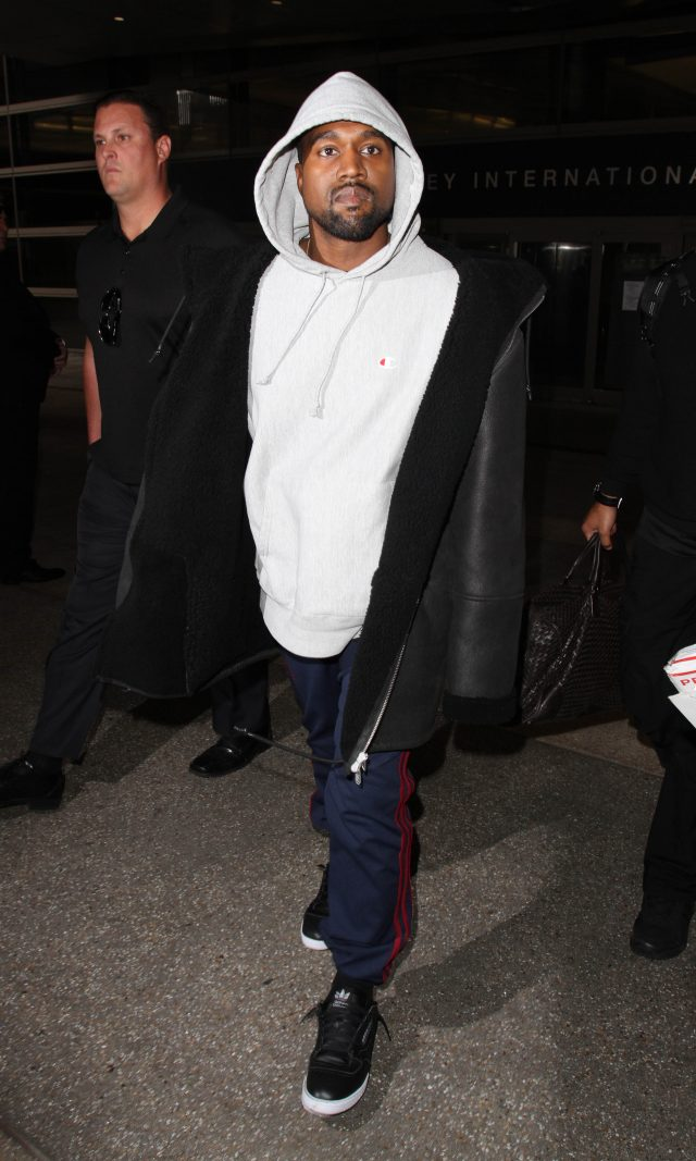 Kanye West is seen arriving in LA only days after his brother in law, Rob Kardashian and Blac Chyna had their baby. (Photo: Splash News)