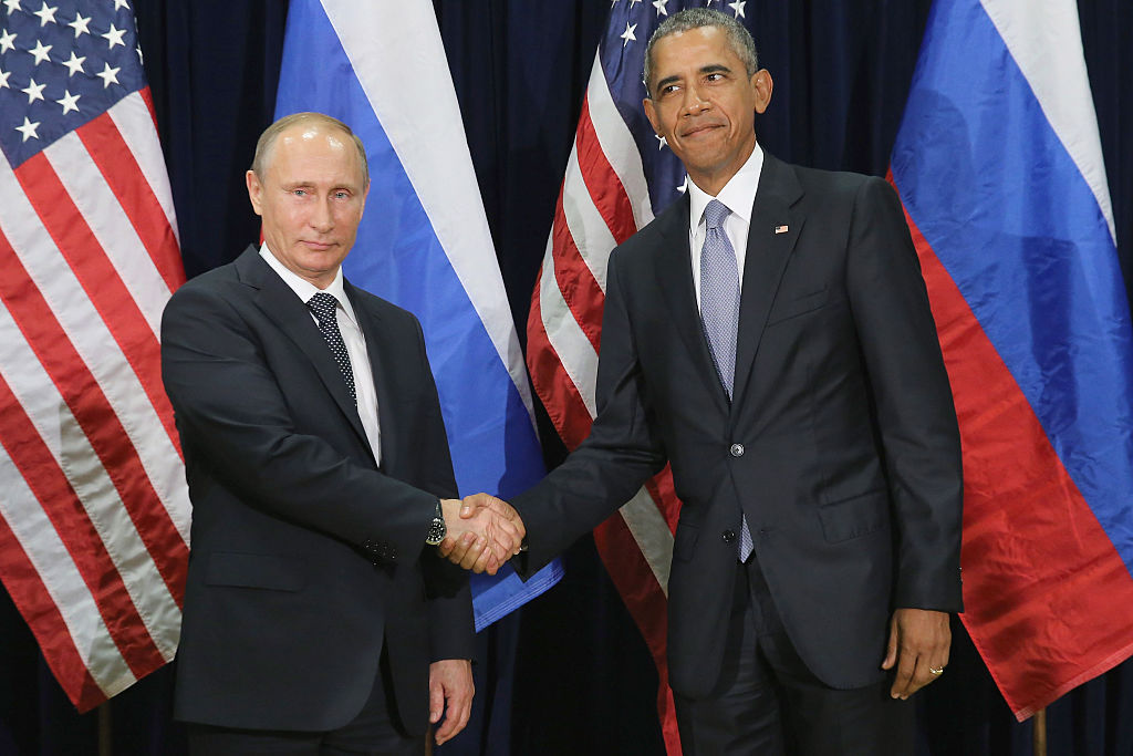 Valdimir Putin and Barack Obama shake hands for the cameras before the start of a bilateral meeting at the United Nations headquarters on September 28, 2015 (Getty Images)
