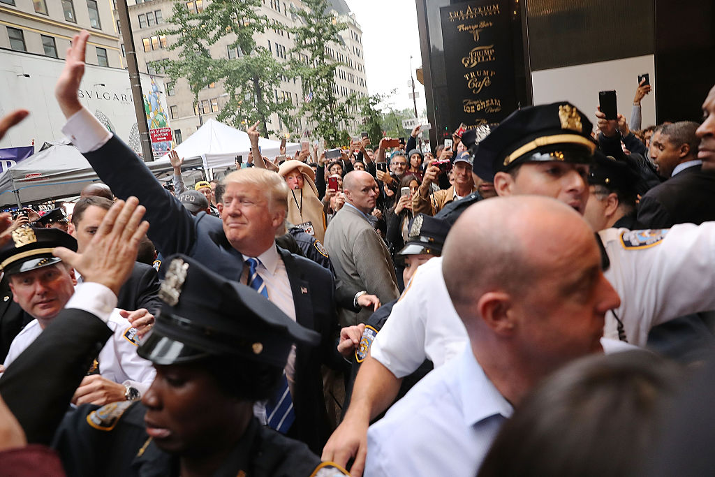 Donald Trump greets supporters outside of Trump Tower in Manhattan on October 8, 2016 (Getty Images)