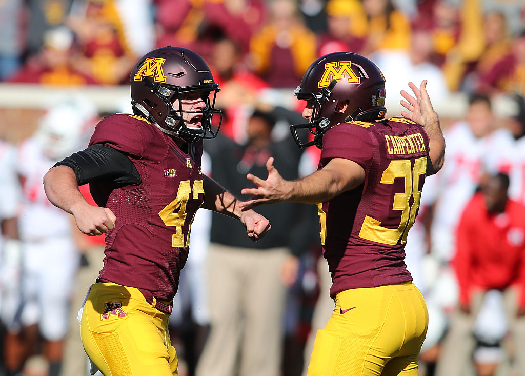 MINNEAPOLIS, MN - OCTOBER 22: Emmit Carpenter #38 and Jacob Herbers #47 of the Minnesota Golden Gophers celebrate the game winning field goal against Rutgers Scarlet Knights in the fourth quarter at TCF Bank Stadium on October 22, 2016 in Minneapolis, Minnesota. Minnesota defeated Rutgers 34-32.(Photo by Adam Bettcher/Getty Images)