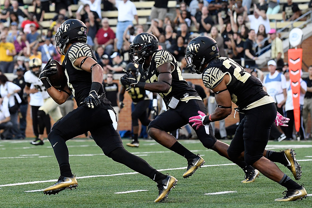 WINSTON SALEM, NC - OCTOBER 29: Defensive back Jessie Bates #3 of the Wake Forest Demon Deacons runs back an intercepted pass against the Army Black Knights at BB&T Field on October 29, 2016 in Winston Salem, North Carolina. (Photo by Mike Comer/Getty Images)