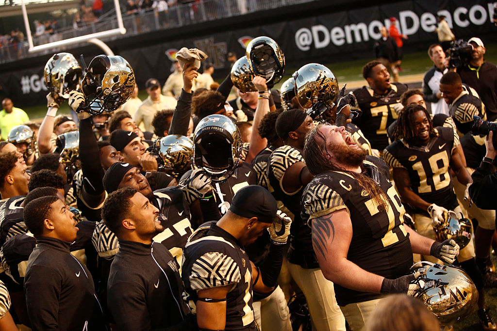 WINSTON-SALEM, NC - NOVEMBER 5: The Wake Forest Demon Deacons celebrate their 27-20 win over the Virginia Cavaliers at the conclusion of an NCAA football game on November 5, 2016 at BB&T Field in Winston-Salem, North Carolina. (Photo by Brian Blanco/Getty Images)