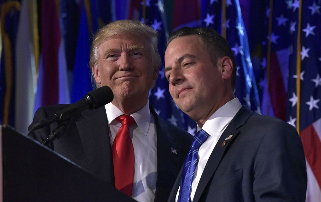Reince Priebus hugs Donald Trump during an election night event at the New York Hilton Midtown (Getty Images)