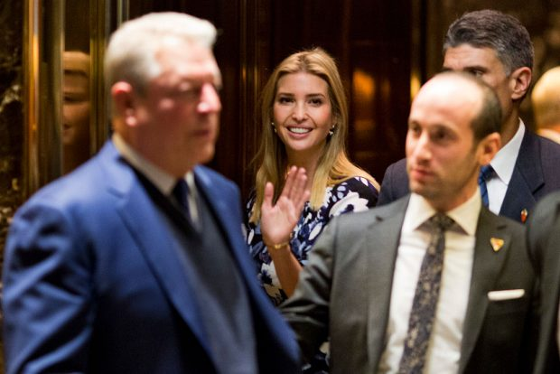Ivanka Trump waves from the elevator as former Vice President Al Gore (L) leaves meetings at Trump Tower in New York City on December 5, 2016. (DOMINICK REUTER/AFP/Getty Images)